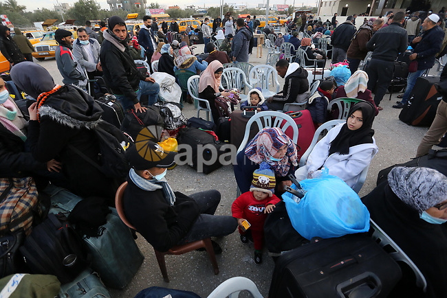 Palestinians wearing protective masks amid the COVID-19 pandemic, as they wait for travel permits to cross into Egypt through the Rafah border crossing, in Rafah in the southern of Gaza Strip, on February 9, 2021. The Rafah border crossing between Egypt and the Gaza Strip will reopen beginning Feb. 9 to allow for the passage of travelers in both directions; authorities have not specified how long the facility would stay open. The Rafah border crossing had been closed as part of efforts to combat the spread of COVID-19; however, authorities have periodically reopened the crossing for several days at a time to permit the repatriation of travelers and the transport of humanitarian cases. Photo by Ashraf Amra