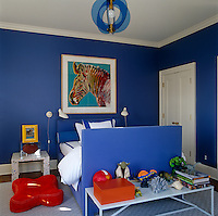 A Gio Ponti light fitting and an Andy Warhol silkscreen above the queen sized bed in this stylish boy's bedroom