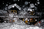 Ski Rental Shop and Gift Shop in falling snow at  night, Longmire entrance, Mount Rainier National Park.
