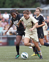Boston College forward Victoria DiMartino (1) dribbles as University of Central Florida defender Marissa Diggs (32) defends. After two overtime periods, Boston College tied University of Central Florida, 2-2, at Newton Campus Field, September 9, 2012.