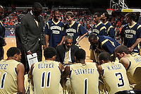 Jan. 22, 2011; Charlottesville, VA, USA; Georgia Tech Yellow Jackets head coach Paul Hewitt talks with his team during the game against the Virginia Cavaliers at the John Paul Jones Arena. Mandatory Credit: Andrew Shurtleff-US PRESSWIRE