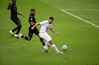 LOS ANGELES, CA - OCTOBER 25: Sebastian Lletget #17 of the Los Angeles Galaxy takes a shot on goal during a game between Los Angeles Galaxy and Los Angeles FC at Banc of California Stadium on October 25, 2020 in Los Angeles, California.