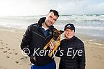 John and Urusla Dowling from Ardfert with their dog Harley enjoying a stroll on Banna Beach on Tuesday.