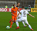 12.09.2020, Donaustadion, Ulm, GER, DFB Pokal, SSV Ulm 1846 Fussball vs FC Erzgebirge Aue, <br /> DFL REGULATIONS PROHIBIT ANY USE OF PHOTOGRAPHS AS IMAGE SEQUENCES AND/OR QUASI-VIDEO, <br /> im Bild Vinko Sapina (Ulm, #22), Philipp Zulechner (Aue, #14), Thomas Geyer (Ulm, #6)<br /> <br /> Foto © nordphoto / Hafner