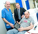 ::  SERCO :: RENAL UNIT WIFI LAUNCH :: SERCO CONTRACT DIRECTOR MIKE MACKAY PRESENTS THE NEW IPAD TO SENIOR STAFF NURSE KEN WEIR AND PATIENT GERALD MATHEWSON FROM WESTQUARTER TO OFFICIALLY LAUNCH THE NEW RENAL UNIT WIFI SERVICE FOR PATIENTS    ::