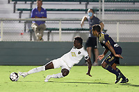 CARY, NC - AUGUST 01: Rudolf Mensah #14 plays the ball while being guarded by Pecka #7 during a game between Birmingham Legion FC and North Carolina FC at Sahlen's Stadium at WakeMed Soccer Park on August 01, 2020 in Cary, North Carolina.