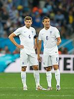 Steven Gerrard and Phil Jagielka of England look dejected