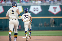 Michigan Wolverines first baseman Jimmy Kerr (15) jogs with teammate Jordan Brewer (22) after his seventh inning home run against the Vanderbilt Commodores during Game 1 of the NCAA College World Series Finals on June 24, 2019 at TD Ameritrade Park in Omaha, Nebraska. Michigan defeated Vanderbilt 7-4. (Andrew Woolley/Four Seam Images)