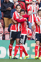 Virgil van Dijk celebrates scoring a goal with Ryan Bertrand after making it 1-0 during the Barclays Premier League match between Southampton v Swansea City played at St Mary's Stadium, Southampton