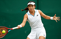 1st July 2021; Wimbledon, SW London. England; Wimbledon Tennis Championships, day 4; Zhu Lin of China competes during the womens singles second round match between Elise Mertens of Belgium and Zhu Lin of China