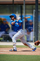 Toronto Blue Jays designated hitter Gabriel Moreno (11) follows through on a swing during a Florida Instructional League game against the Pittsburgh Pirates on September 20, 2018 at the Englebert Complex in Dunedin, Florida.  (Mike Janes/Four Seam Images)
