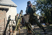 Pro-Russian rebels shoot mortars toward Ukrainian army positions in Donetsk