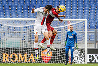Genoa's Eldor Shomurodov, left, and Roma's Gianluca Mancini jump for the ball during the Italian Serie A Football match between Roma and Genoa at Rome's Olympic stadium, March 7, 2021.<br /> UPDATE IMAGES PRESS/Riccardo De Luca