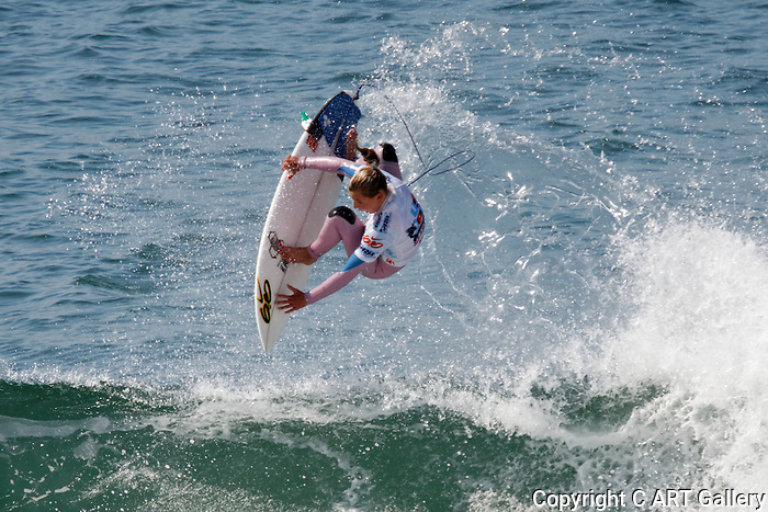 Surf Rider - Huntington Beach, California.  Photograph by Alan Mahood.