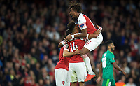 Alex Iwobi of Arsenal celebrates with goalscorer Pierre-Emerick Aubameyang of Arsenal during the UEFA Europa League match group between Arsenal and Vorskla Poltava at the Emirates Stadium, London, England on 20 September 2018. Photo by Andrew Aleks / PRiME Media Images.