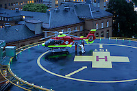 Norwegian Air Ambulance helicopter delivers patient at Ullevaal hopsital in Oslo, Norway.