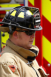 A firefighter portrait by a fire engine