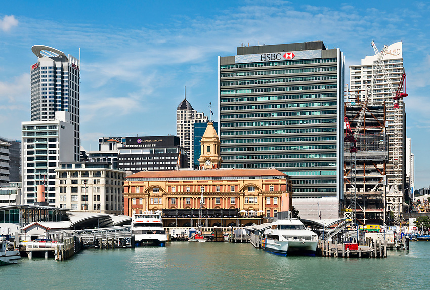View of the waterfront of Auckland from the ferry to Waiheke Island. The building in the center is the ferry building.