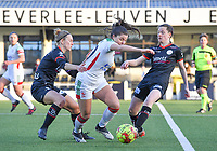 Pauline Windels (5) of Zulte-Waregem pictured fighting for the ball with Luna Vanzeir (10) of OHL and Summer Rogiers (8) of Zulte-Waregem during a female soccer game between Oud Heverlee Leuven and SV Zulte-Waregem on the 16 th matchday of the 2020 - 2021 season of Belgian Womens Super League , sunday 14 th of March 2021  in Heverlee , Belgium . PHOTO SPORTPIX.BE | SPP | DAVID CATRY