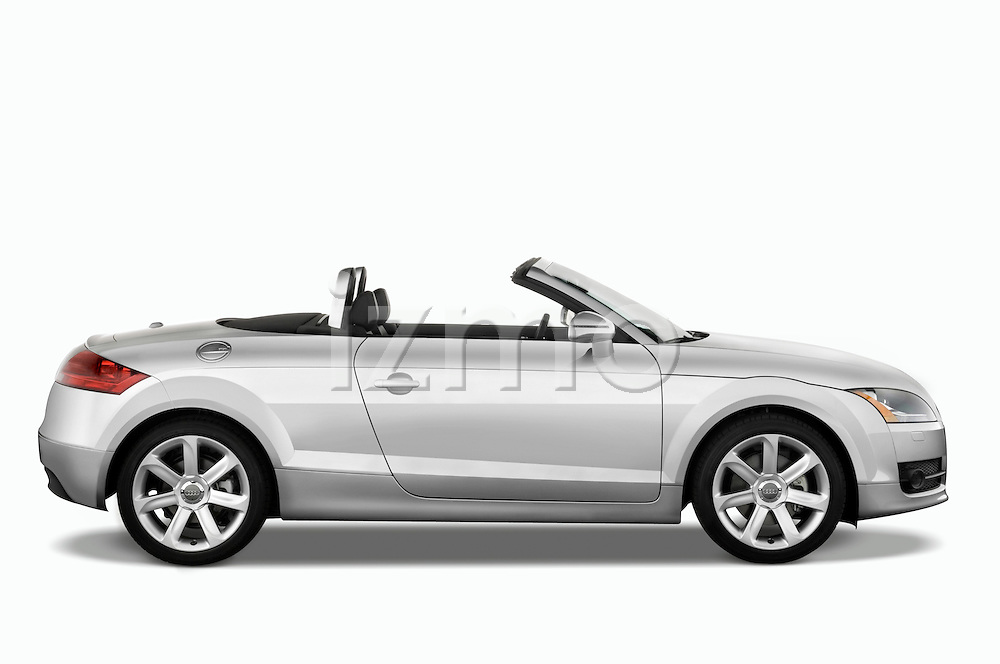 Passenger side profile view of a 2007 - 2010 Audi TT Roadster with top down