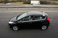 Pictured: A Swansea supporters's car travelling on the M4 motorway making their way to Wembley Stadium. Sunday 24 February 2013<br /> Re: Capital One Cup fooball final, Swansea v Bradford at the Wembley Stadium in London.