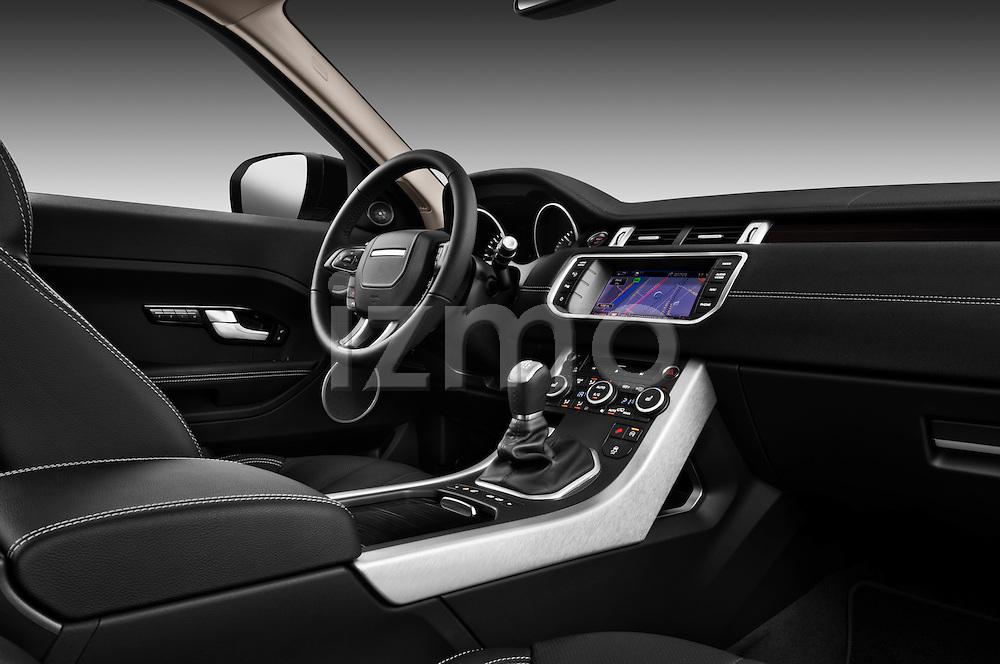 Passenger side dashboard view of a 2011 Land Rover Range Rover Evoque SUV.