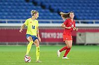 YOKOHAMA, JAPAN - AUGUST 6: Nathalie Bjorn #14 of Sweden controls the ball during a game between Canada and Sweden at International Stadium Yokohama on August 6, 2021 in Yokohama, Japan.