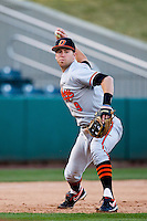 Mark Ginther (9) of the Oklahoma State Cowboys throws to first base during a game against the Missouri State Bears at Hammons Field on March 6, 2012 in Springfield, Missouri. (David Welker / Four Seam Images)