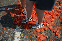 Kristen Novotny (left), Spanish teacher at Springdale High School, and Ellen Rainey, Spanish teacher at Har-Ber High School, smash tomatoes Thursday, Sept. 9, 2021, during the Tomatina, a tomato fight with historical roots in Spain, in Murphy Park in Springdale. Advanced placement Spanish language students from Springdale and Har-Ber high schools participated in the event. Visit nwaonline.com/210910Daily/ for today's photo gallery.<br /> (NWA Democrat-Gazette/Andy Shupe)