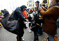 Photo: Richard Lane/Richard Lane Photography. Wasps v Newcastle Falcons. Aviva Premiership. 06/02/2016. Wasps' George Smith signs autographs for supporters as the team arrive at the stadium.