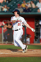 Brandon Grudzielanek (21) of the Lansing Lugnuts follows through on his swing against the South Bend Cubs at Cooley Law School Stadium on June 15, 2018 in Lansing, Michigan. The Lugnuts defeated the Cubs 6-4.  (Brian Westerholt/Four Seam Images)
