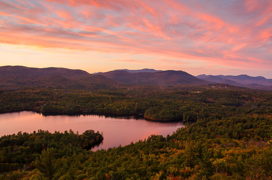 A pink sky augments autumns color in this view of Squam Lake.