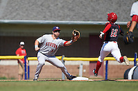 Auburn Doubledays first baseman David Kerian (21) stretches for a throw as Corey Bird (12) runs through the bag during the first game of a doubleheader against the Batavia Muckdogs on September 4, 2016 at Dwyer Stadium in Batavia, New York.  Batavia defeated Auburn 1-0 in a continuation of a game started on August 13. (Mike Janes/Four Seam Images)