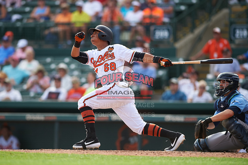 Baltimore Orioles designated hitter Chris Bostick (68) follows through on a swing during a Grapefruit League Spring Training game against the Tampa Bay Rays on March 1, 2019 at Ed Smith Stadium in Sarasota, Florida.  Rays defeated the Orioles 10-5.  (Mike Janes/Four Seam Images)