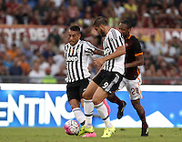 Calcio, Serie A: Roma vs Juventus. Roma, stadio Olimpico, 30 agosto 2015.<br /> Juventus' Roberto Pereyra, left, and Alvaro Morata fight for the ball against Roma's Seydou Keita, right, during the Italian Serie A football match between Roma and Juventus at Rome's Olympic stadium, 30 August 2015.<br /> UPDATE IMAGES PRESS/Isabella Bonotto