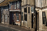 United Kingdom, England, Suffolk, Lavenham: View along medieval timber framed cottages on Water Street