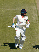16th April 2021; Emirates Old Trafford, Manchester, Lancashire, England; English County Cricket, Lancashire versus Northants; Matt Parkinson of Lancashire  watches the shot into the outfield as he runs