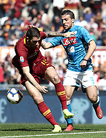 Football, Serie A: AS Roma - SSC Napoli, Olympic stadium, Rome, March 31, 2019. <br /> Roma's Davide Santon (l) in action with Napoli's Simone Verdi (r) during the Italian Serie A football match between Roma and Napoli at Olympic stadium in Rome, on March 31, 2019.<br /> UPDATE IMAGES PRESS/Isabella Bonotto