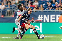 FOXBOROUGH, MA - JULY 7: Henry Kessler #4 of New England Revolution shields Ayo Akinola #20 of Toronto FC from the ball as it rolls back to the goalie during a game between Toronto FC and New England Revolution at Gillette Stadium on July 7, 2021 in Foxborough, Massachusetts.