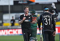 NZ's Jimmy Neesham (centre) celebrates his five-wicket bag during the third One Day International cricket match between the New Zealand Black Caps and Bangladesh at the Basin reserve in Wellington, New Zealand on Friday, 26 March 2021. Photo: Dave Lintott / lintottphoto.co.nz