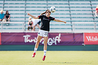 CARY, NC - SEPTEMBER 12: Morgan Weaver #22 of the Portland Thorns heads the ball before a game between Portland Thorns FC and North Carolina Courage at WakeMed Soccer Park on September 12, 2021 in Cary, North Carolina.