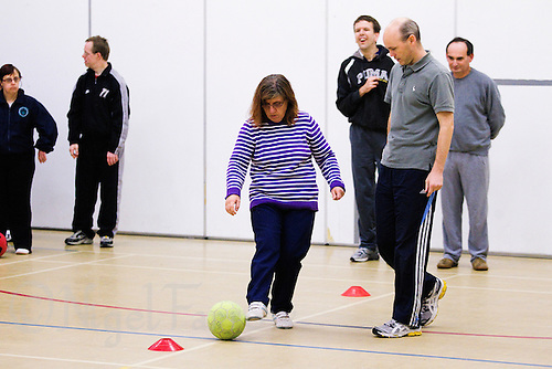 20 OCT 2011 - DISS, GBR - Iain Dawson aids one of the members of the Diss Ability multi sport club for people with learning disabilities that he helped to found after becoming aware of its need during his work as a physiotherapist (PHOTO (C) NIGEL FARROW)