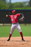 Washington Nationals third baseman Omar Meregildo (12) throwing during a Minor League Spring Training game against the Houston Astros on April 27, 2021 at FITTEAM Ballpark of the Palm Beaches in Palm Beach, Fla.  (Mike Janes/Four Seam Images)