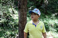 A young boy visiting the Jiuzhaigou National Park. Sichuan Province. China.