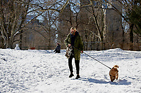 NEW YORK, NEW YORK - FEBRUARY 21: A woman walks with her dog in Central Park covered by snow and ice  on February 21, 2021 in New York City. The big apple waits this monday the last snowfall before a midweek warm up.  (Photo by John Smith/VIEWpress via Getty Images)