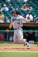 Biloxi Shuckers first baseman Dylan Moore (18) follows through on a swing hits a double during a game against the Montgomery Biscuits on May 8, 2018 at Montgomery Riverwalk Stadium in Montgomery, Alabama.  Montgomery defeated Biloxi 10-5.  (Mike Janes/Four Seam Images)