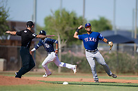 Texas Rangers third baseman Tyler Ratliff (32) prepares to throw to first base during an Instructional League game against the San Diego Padres on September 20, 2017 at Peoria Sports Complex in Peoria, Arizona. (Zachary Lucy/Four Seam Images)