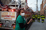 A healthcare worker tears up as firefighters honor healthcare workers in front of the Wyckoff Heights Medical Center during the coronavirus pandemic (COVID-19) in the Brooklyn borough of New York City on April 5, 2020.  Photograph by Michael Nagle