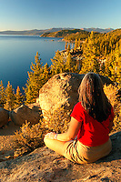 Female visitor (MR) viewing Lake Tahoe from  the Nevada side looking towards California.  Model Released.