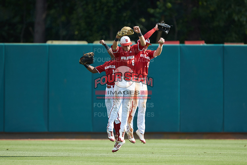 (L-R) North Carolina State Wolfpack outfielders Terrell Tatum (1), Brett Kinneman (6), and Brock Deatherage (13) celebrate their win over the Army Black Knights at Doak Field at Dail Park on June 3, 2018 in Raleigh, North Carolina. The Wolfpack defeated the Black Knights 11-1. (Brian Westerholt/Four Seam Images)